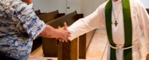 Congregant shaking hands with Pastor